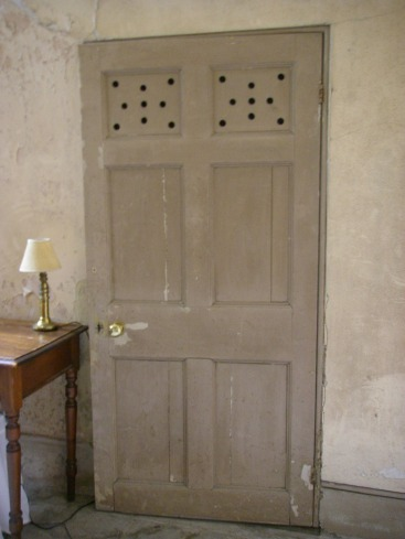 servants door with vent holes